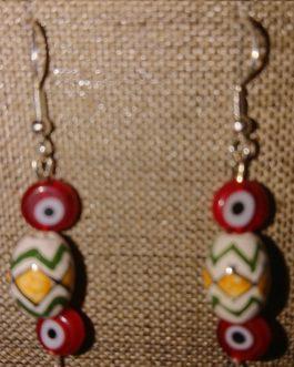 Boucles d'oreilles oeils rouges perle péruvienne